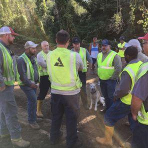 Crews huddle before work begins on outage restoration. (Alabama Power file)
