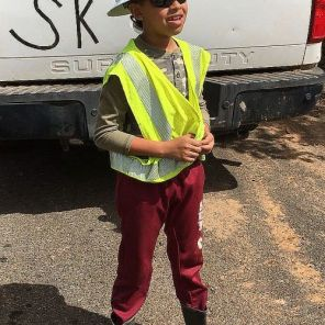 Young boy wears an Alabama Power safety hat while in Puerto Rico. (Alabama Power file)