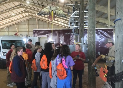 High School students learn what happens when a hawk hits a powerline at Southeast Worlds of Work in Dothan. (Linda Brannon/Alabama NewsCenter)