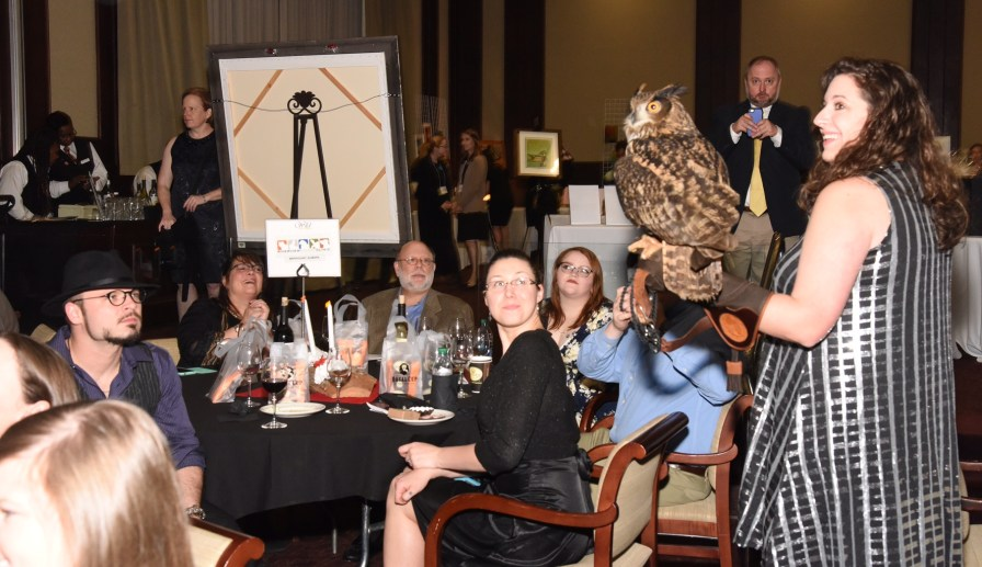 """Guests enjoying 2017 Wild About Chocolate 2017, playing the """"Talons and Tailfeathers"""" game, and meeting AWC's live education raptors. (Alabama Wildlife Center)"""