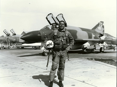 """Col. Daniel """"Chappie"""" James stands in front of his McDonnell-Douglas F-4C Phantom fighter jet in the mid-1960s. During the Vietnam War, James was stationed in Thailand and flew nearly 80 missions over Vietnam. (From Encyclopedia of Alabama, United States Air Force)"""
