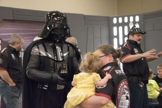 A young fan reluctantly greets Darth Vader. (Brittany Faush / Alabama NewsCenter)