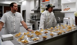 Chefs Will Sams, left, and Bill Briand serve up shrimp and grouper ceviche with cumin cracker. (Michael Tomberlin / Alabama NewsCenter)
