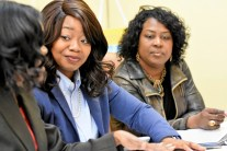 Adriene Gadsden, center, takes part in a meeting at the Housing Authority Birmingham District office with HABD's Dontrelle Young-Foster, left, and Hollyhand Development Vice President Marcella Roberts. (Solomon Crenshaw Jr./Alabama NewsCenter)