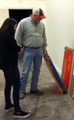 """Scott Morrow, Southern Custom Exhibits, shows Julia Meyer, Tatum Design, some of the production materials for the """"Making Alabama"""" exhibition. AlabamaNewsCenter)"""