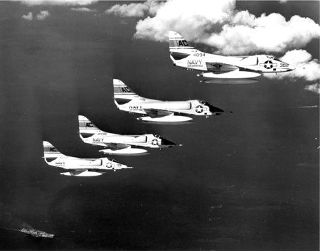 """Four Douglas A4D-2 Skyhawk Attack Squadron 34 """"Blue Blasters"""" in flight. The aircraft flew sorties over combat areas during the Bay of Pigs Invasion, Cuba, on April 17-19, 1961. (U.S. Department of State, Office of the Historian, Robert L. Lawson, Wikipedia)"""