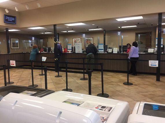 Customer Service Representatives help customers inside the business office. (Keisa Sharpe/Alabama NewsCenter)