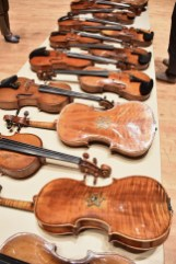 Violins of Hope restored by Amnon Weinstein. The violins were owned and played by inhabitants of concentration camps and ghettoes during the Holocaust. (Karim Shamsi-Basha/Alabama NewsCenter)