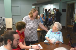 Catherine Findley, center, brought Cyber-Seniors to the CJSF and other Birmingham elderly communities. (Karim Shamsi-Basha / Alabama NewsCenter)