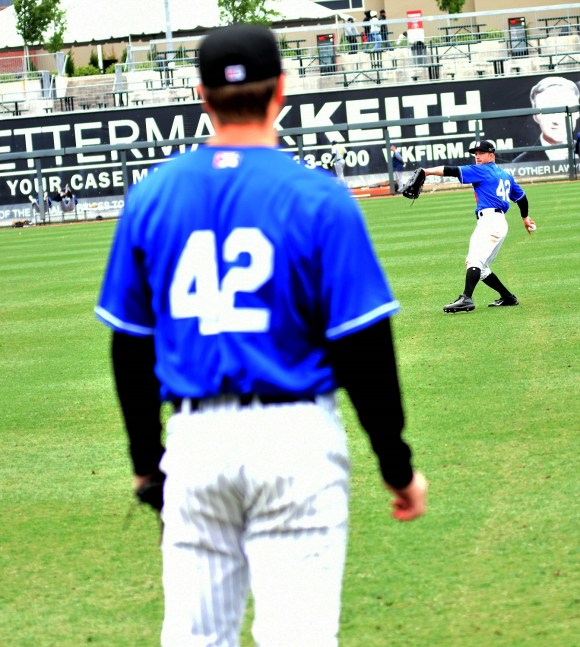 Two members of the Birmingham Barons play catch prior to Game 2 of a doubleheader on Sunday. All of the Barons are wearing No. 42 in observance of Jackie Robinson Day. (Solomon Crenshaw Jr./Alabama NewsCenter)