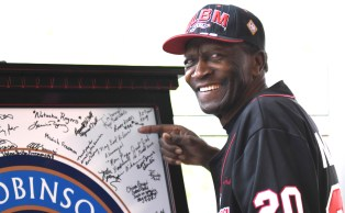 """Former Negro Leaguer Leroy """"Pirate"""" Miller Jr. points to his signature on a Jackie Robinson display at Negro Southern League Museum. The Leeds resident played for the Birmingham Black Barons and the Philadelphia Stars. (Solomon Crenshaw Jr./Alabama NewsCenter)"""