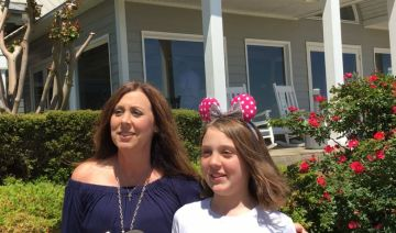 Mom Brandi Vines (left) and Lizzy are thrilled about their trip to Disney World. (Donna Cope/Alabama NewsCenter)