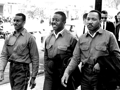 """Fred Lee Shuttlesworth (left), Ralph David Abernathy (center) and Martin Luther King Jr. (right) march on Good Friday on April 12, 1963, in Birmingham. The men were later arrested, prompting King to write his famous """"Letter from Birmingham Jail."""" (From Encyclopedia of Alabama, courtesy of Birmingham Public Library Archives)"""