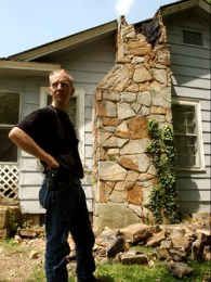 Brent Bentley stands in his yard near his earthquake-damaged chimney. It collapsed when an earthquake rocked the town of Valley Head. The earthquake, which measured 4.6 on the Richter scale, occurred on April 29, 2003, and was felt by people in 11 states in the Southeast. (From Encyclopedia of Alabama, courtesy of Philip Barr, the Birmingham News)