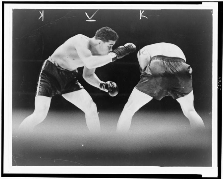 Joe Louis looks for an opening during boxing match with Max Schmeling, 1936. (World-Telegram staff photo, Library of Congress, Prints and Photographs Division)