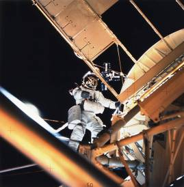 Astronaut Owen Garriott performs a spacewalk at the Apollo Telescope Mount (ATM) of the Skylab space station cluster in Earth orbit, photographed with a hand-held 70mm Hasselblad camera. Garriott had just deployed the Skylab Particle Collection S149 Experiment. The experiment was mounted on one of the ATM solar panels. The purpose of the S149 experiment was to collect material from interplanetary dust particles on prepared surfaces suitable for studying their impact phenomena. Earlier during the spacewalk, Garriott assisted astronaut Jack Lousma, Skylab 3 pilot, in deploying the twin pole solar shield. (NASA)