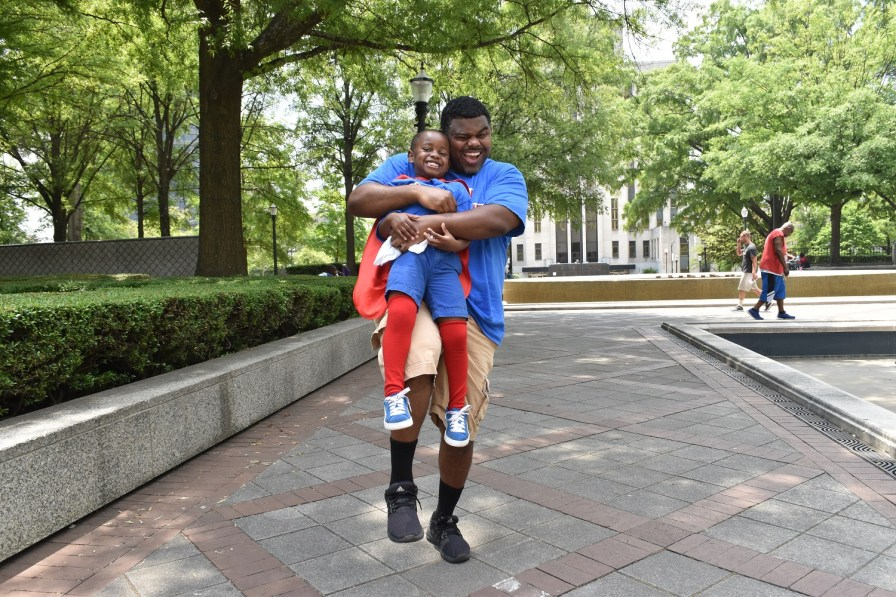 T.J. Perine is a proud dad. (Karim Shamsi-Basha/Alabama NewsCenter)