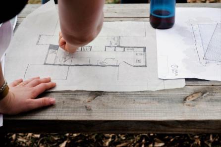 The Horseshoe Farm Homes team shows a sample home layout. (Rob Culpepper)