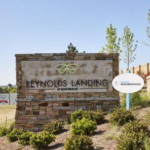 Sign greets residents of the new community. (Laurey Glenn)