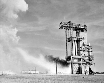 The first full engine assembly static firing is seen at Marshall Space Flight Center's static test tower in Huntsville, Madison County, in May 1960. (From Encyclopedia of Alabama, Library of Congress)