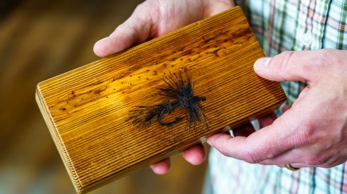 An image of a fishing lure burned into a block of heart pine by Andrew Lee. (Mark Sandlin/Alabama NewsCenter)