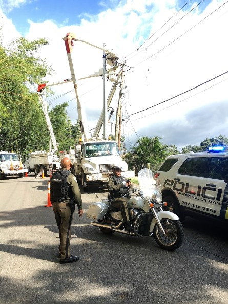 Linemen work to restore power in Puerto Rico after Hurricane Maria. The Edison Electric Institute recognized Alabama Power for its work. (file)