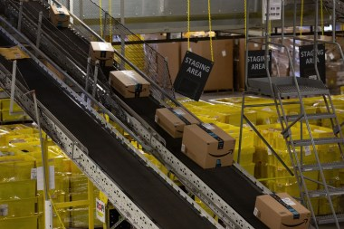 Packages move along a conveyor belt at the Amazon.com Inc. fulfillment center in Robbinsville, New Jersey. (Bess Adler/Bloomberg)