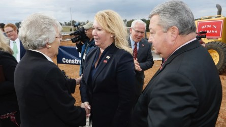 Aerojet Rocketdyne CEO Eileen Drake shakes hands with Gov. Kay Ivey as Commerce Secretary Greg Canfield looks on at the 2017 groundbreaking ceremony for the company's new manufacturing facility in Huntsville, which was completed recently. (Hal Yeager/Governor's Office)