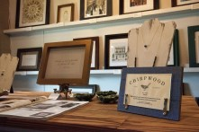 Chirpwood's Scott Moody creates a frame to complement the specific piece it's framing. (Brittany Faush/Alabama NewsCenter)