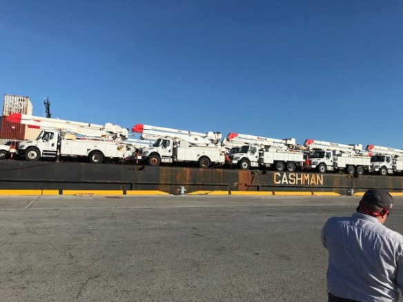 Trucks from Alabama Power and other Southern Company utilities wait to be unloaded at the dock in Puerto Rico. The Edison Electric Institute honored Alabama Power for its work. (file)