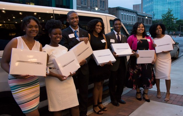 Jordyn Cannon, E'shandae Thomas, Christion Finch, Dasia Primus, Christopher Pilgrom, Caitlyn Jones and Brooklin Ballard, the Magnificent Seven debate team graduates, pose with their laptops donated by Jim Kennemer of Vision Research Corporation. (contributed)