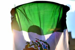 A Mexican fan celebrates with a Mexican flag after winning hosting rights for the 2026 FIFA World Cup in conjunction with the United States and Canada on June 13 in Moscow, Russia. (Hector Vivas/Getty Images )