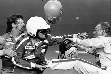 Donnie (far left) and Bobby Allison (wearing helmet) fight Cale Yarborough following the Daytona 500 in February 1979 in Daytona Beach, Florida. Yarborough was involved in a wreck with Donnie Allison near the end of the race. (From Encyclopedia of Alabama, photograph by Ric Feld, courtesy of the Associated Press)