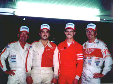 """Allison family NASCAR personalities, from left: father and son Donnie and Kenny Allison, and son and father Davey and Bobby Allison. Brothers Donnie and Bobby Allison, along with Charles """"Red"""" Farmer, formed the core of the Alabama Gang of successful NASCAR drivers based in Hueytown, Jefferson County. (From Encyclopedia of Alabama, courtesy of Bobby Allison Racing Inc.)"""