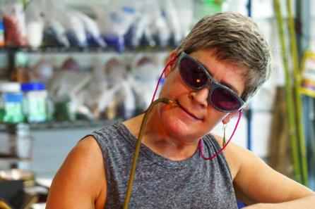 Heather Hepp of Little Sandy Glass in Tuscaloosa has a burning passion for working with glass. (Mark Sandlin / Alabama NewsCenter)