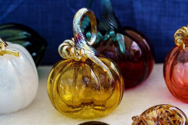 Glass pumpkins are among Heather Hepp's specialty at Little Sandy Glass. (Mark Sandlin / Alabama NewsCenter)