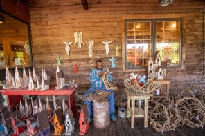 Andrew McCall's favorite creations include bird houses, baskets, wooden angels, crosses and miniature churches, although he also builds furniture. (Mark Sandlin/Alabama NewsCenter)