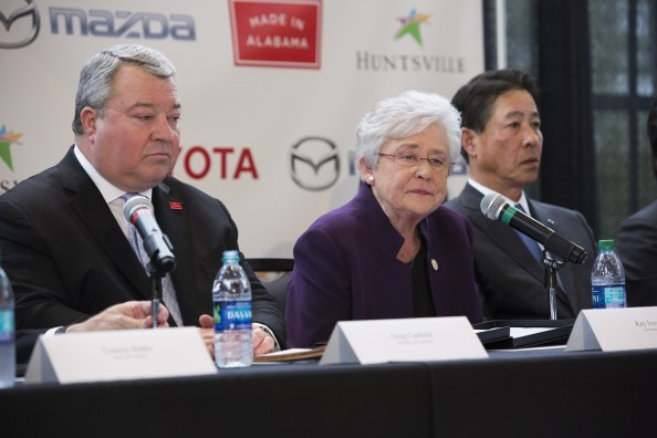 Gov. Kay Ivey and Commerce Secretary Greg Canfield speak to the press following the Toyota-Mazda auto plant announcement in January. (Rob Culpepper)