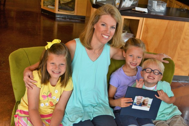 "Erin Miller with her children, Kate, Jenna and Elijah. The family's journey through Kate's struggle with leukemia is told in Erin's book, ""Fighting for Kate."" (Karim Shamsi-Basha/Alabama NewsCenter)"