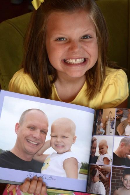 Kate Miller shows a photo of her with her dad, Brandon Miller. (Karim Shamsi-Basha/Alabama NewsCenter)