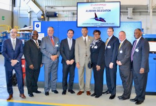 Representatives from Macon County pose with Leonardo officials before a tour of the company's aircraft factory in Italy. (contributed)