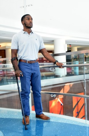 Montaeus Bell stands in the lobby of Children's of Alabama. (Solomon Crenshaw Jr./Alabama NewsCenter)