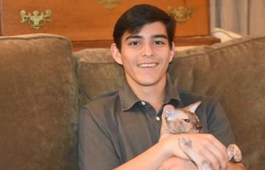 Ziven Fowler with his Russian Peterbald cat, Phebe. (Solomon Crenshaw Jr./Alabama NewsCenter)