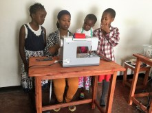 Stacey Scott demonstrates sewing for some children. (contributed)