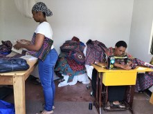 Stacey Scott, left, teaches Tanzanian women how to make western-style clothing in a converted room at African Integrative Medicine, where Scott is executive director. (contributed)