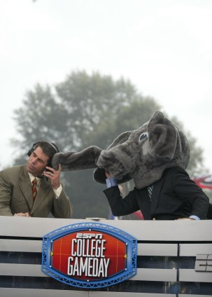 ESPN College Gameday's Lee Corso, right, has often put on Big Al's head as part of his headgear picks. (Paul W. Bryant Museum / The University of Alabama)