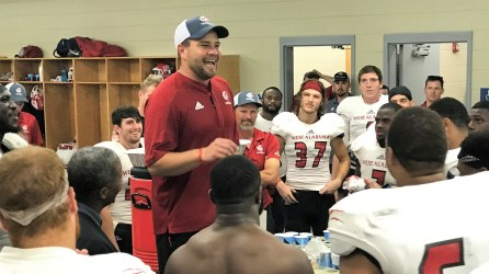 A revved-up Coach Brett Gilliland talks with his players. (West Alabama Athletics)