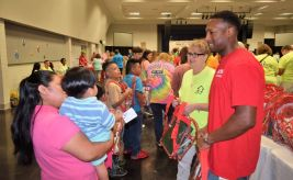 Capstone's Marcy Brown (right), with Oliver (right), talked with families. (Donna Cope/Alabama NewsCenter)