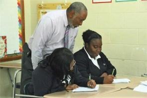Math teacher Wade White helps student Sarah Evans. (Karim Shamsi-Basha / Alabama NewsCenter)