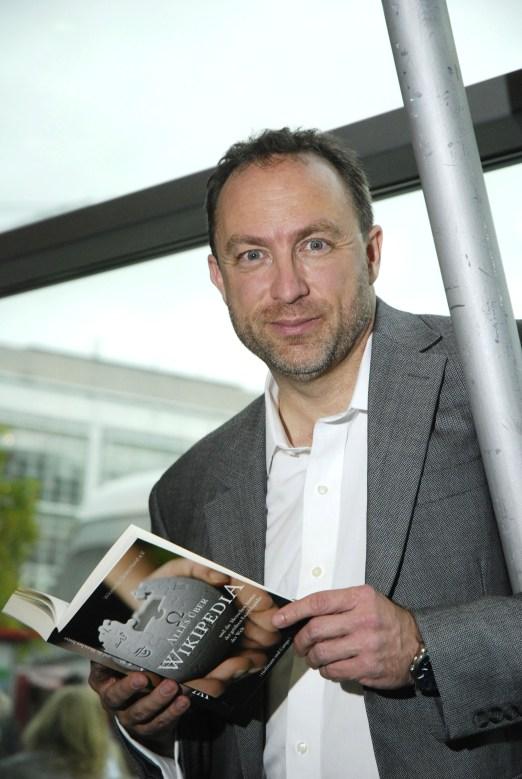 Jimmy Wales with German Wikipedia book, 2011. (teutopress/Thomas Gebauer, Wikipedia)
